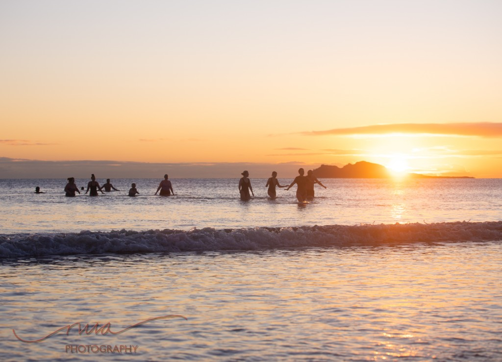 Swimmers at sunrise Pormarnock